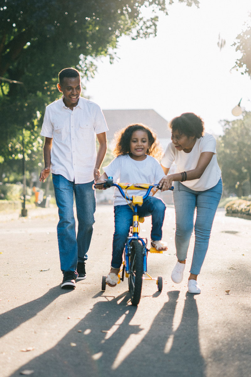Kid Learn To Ride Bike With Family