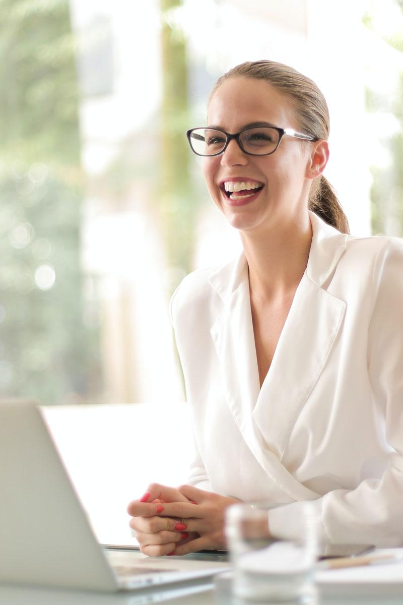 Women At Desk Laughing